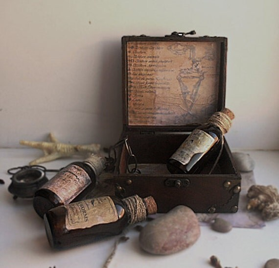 Magic potion bottles in the vintage wooden chest - mysterious fantasy halloween gift box