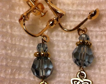 Indian sapphire and gold plated clip ons with Celtic charms.