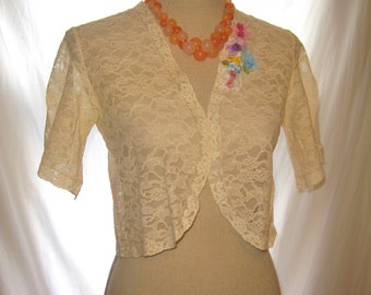 Small to medium size beige color lace bolero jacket enhanced with delicate flowers, beige floral lace bolero shrug, lace bolero jacket