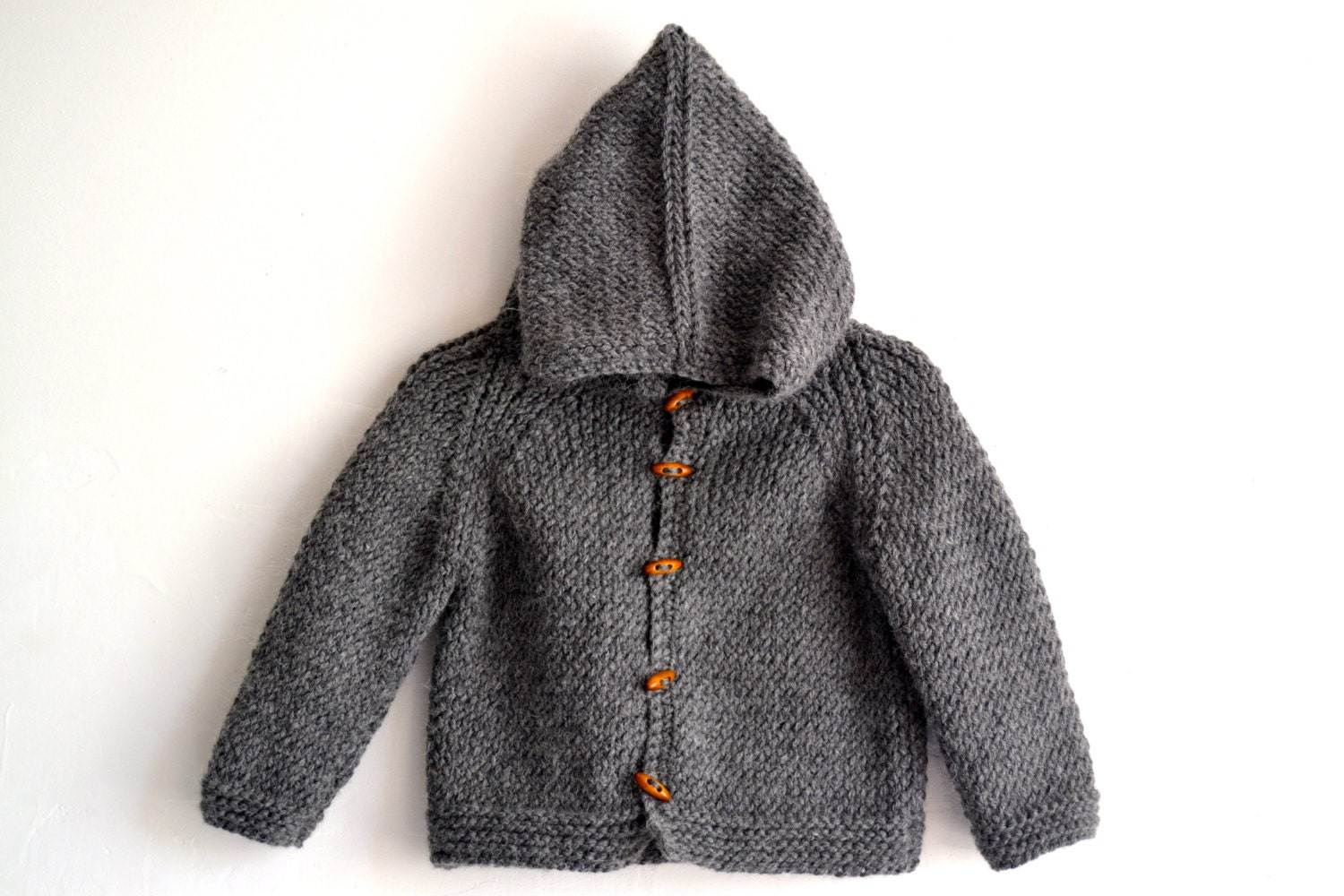 Miou Kids Hand-Knitted Clothing For Babies and Children. We create fair-trade, hand-knitted and hand-crocheted designer clothing for kids. The quality of our garments is unsurpassed and combines original designs, the highest level of craftsmanship, and the best eco-friendly baby alpaca wool and organic cotton available.
