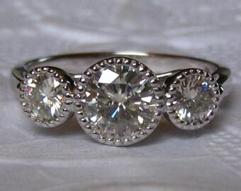 Three Stone Moissanite Engagement Ring in White Gold Milgrain Bezels