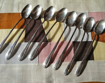 Set of 4 iced tea, ice cream sundae spoons.