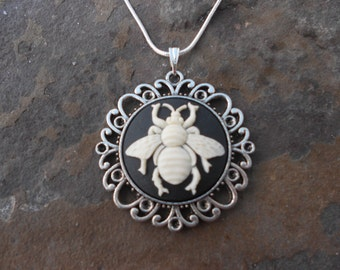 "Stunning Ivory Bee (on a black background) Cameo Pendant Necklace---.925 plated 22"" Chain--- Great Quality"