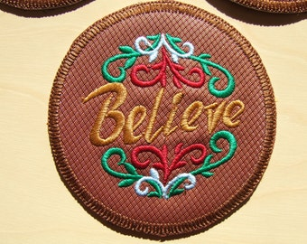 """set of 6 coasters, embroidered on pleather, fully lined, """"Believe"""" embrodiered."""
