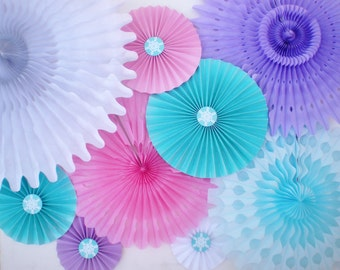 Frozen party backdrop, tissue fans and paper rosettes, pink, lavender, aqua, white, light blue with GLITTER