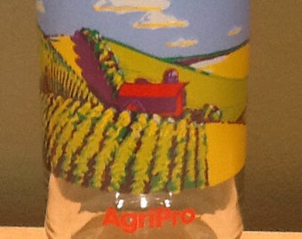 Vintage collectible souvenir drinking glass from AgriPro. Has beautiful colorful graphics of a farm scene.