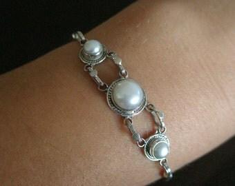 3 silver pearls bracelet