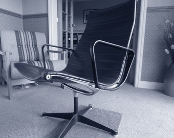 An Early Herman Miller Eames Aluminium Group Mid Century Swivel Chair