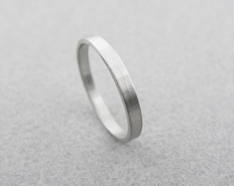 Wedding rings.2.5 x 1.2mm.14k White gold wedding ring in Brushed finish.Hand forged wedding rings.