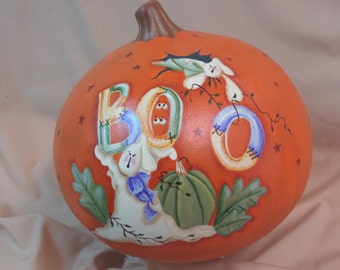 Halloween pumpkin with ghosts and BOO