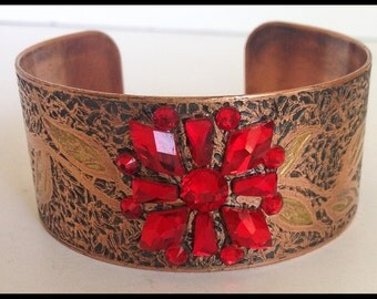 handcrafted, one-of-kind art deco inspired, etched copper cuff bracelet with red  Swaravski crystals forming a flower motif