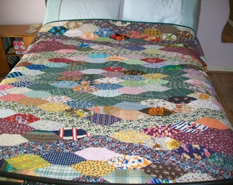 Handmade VINTAGE hand pieced long hexagon patchwork, remade into a beautiful quilt - looks great in the garden.