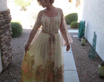 Vintage Imagnin, cream with orange floral, sheer flowing lined long dress with a back zip.