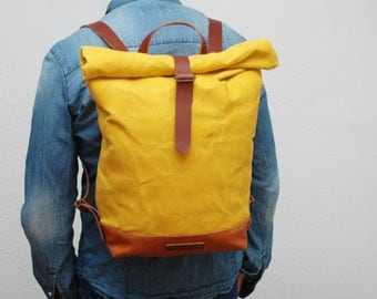 waxed Canvas rucksack/backpack, yellow color, hand waxed , with handles, leather base  and closures