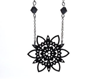 Barbara Collier - Baroque lace plant in gloss black acrylic pattern cutting laser and Swarovski beads