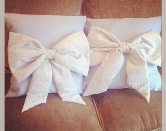 Handmade blue linen cushions withpuffy pinstriped bow