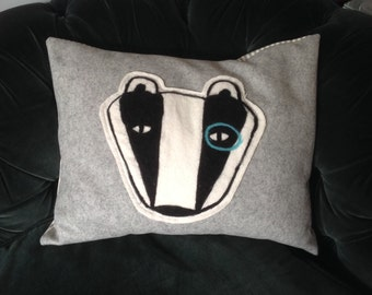 Needlefelted badger cushion.