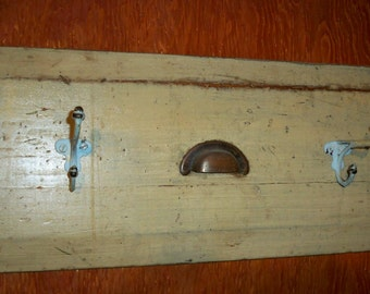 Repurposed drawer front coat hooks
