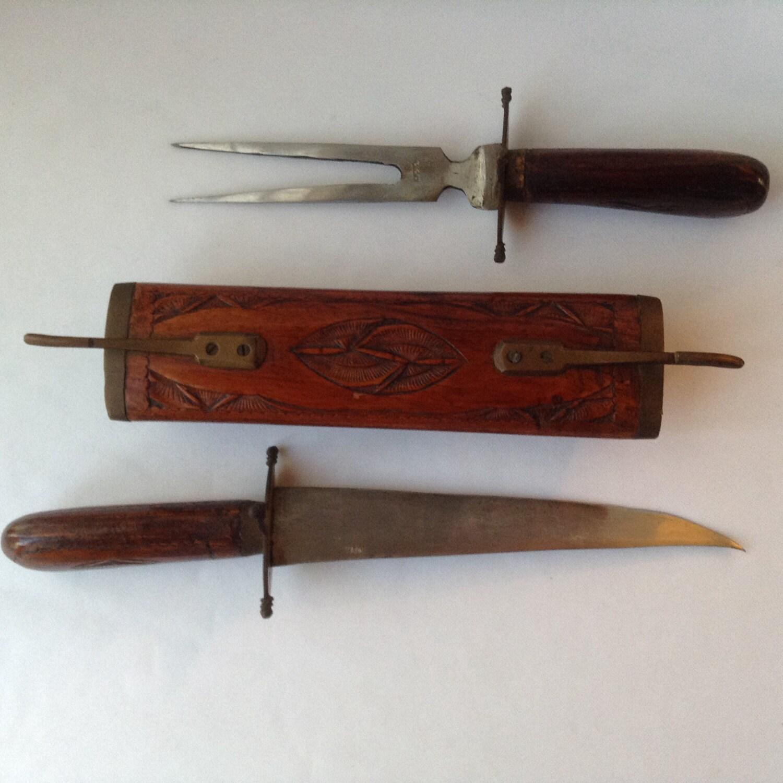 Hand carved knife and fork carving set