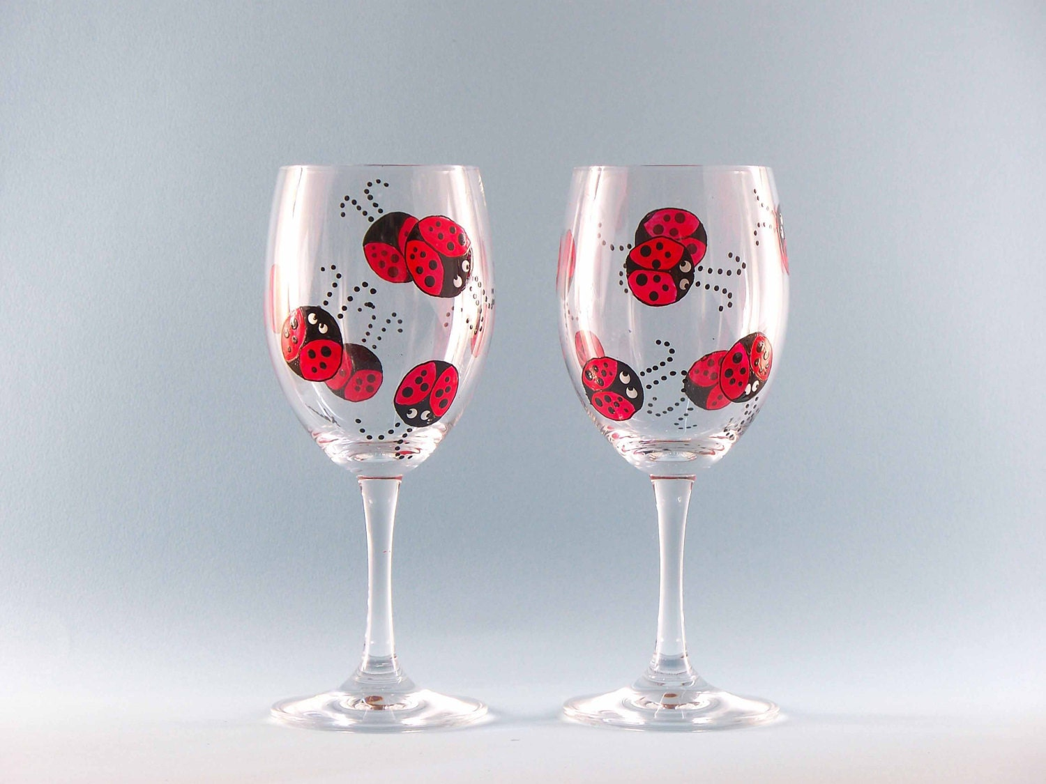 Hand painted ladybug wine glasses cute ladybug design for What can you paint glass with