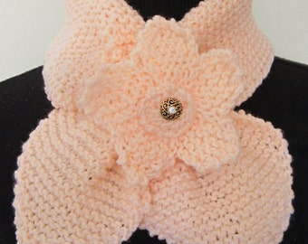 Scarf, Ladies Neck Warmer knitted with acrylic yarn decorated with a matching apricot flower with a glittery scrolled button in its center.