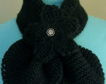 Scarf, Ladies Neck Warmer knitted with acrylic yarn decorated with a matching black flower with silver/black button in its center.