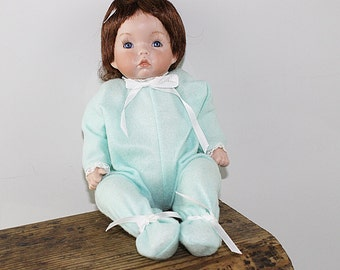 Porcelain Doll with Porcelain Hands in Newborn Outfit