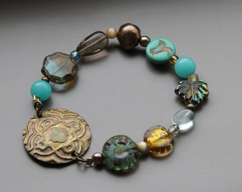 Gold and turquoise beaded bracelet with bronze medallion
