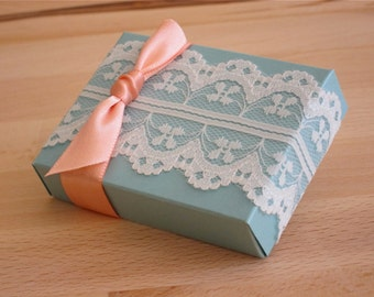 A set of 65 wedding favor box with lace trim and ribbon