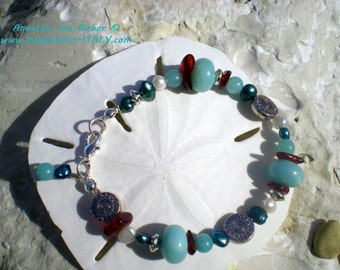 MYSTERIOUS DROPS Bracelet with Amazonite, Amber, Freshwater Pearls, Inca metal ornaments and snap hook in silver.