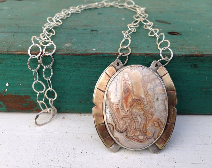 Mexican crazy lace agate with handmade Sterling silver and brass pendant with silver chain