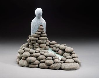 Dam it…I'm Trying to Hold it Together, Ceramic Sculpture, soul figure with rocks and water