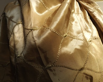 Gold taffeta fabric with embroidered pattern in gold