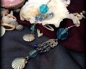 shell charm earrings with blue accents, mermaid