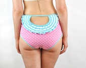 Pink polka dot panties with blue stripey rosette open back
