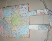 Pieced and quilted tote bag. Quilt pattern is friendship star. Lined in pink Batik.
