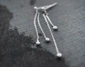 Dancing solid silver grains long earrings