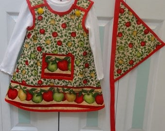 TODDLER'S DRESS SET, size 4 to 5 ,white polo shirt and scarf set, apple pattern print, red trim, large pocket in front.