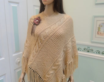 """HAND KNITTED PONCHO: Chamois/buff/beige color yarn, cable pattern stitch, 5"""" fringe, removable leather pin"""