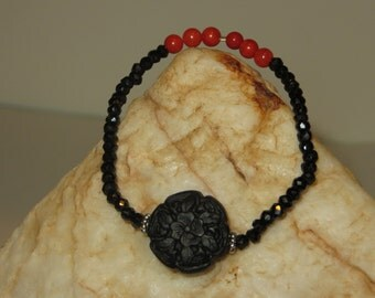 Black Carved Cinnabar and Crystal Bracelet with Red Coral Beads