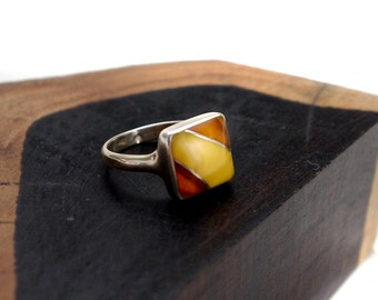 small ring of honey and caramel coloured amber set in sterling silver, sizes: 6.5 and 7.75