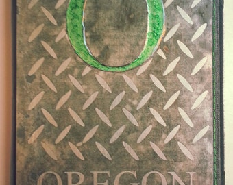 "Custom etched metal e-reader cover-Oregon ""O"" with diamondplate pattern"