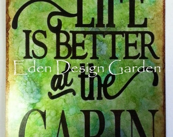 "Life is Better at the CABIN etched metal sign in blue and green 8""x12"""