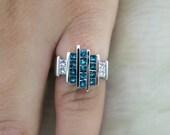 18k White gold Blue and white princess cut diamond channel set ring.
