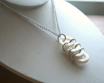 4 Ring Cream Pendant with Chain