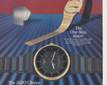 1985 Pulsar 2011 Series Advertisement One Step Alarm Analog Gold Black 80s Mens Fashion Jewelry Wall Art Decor