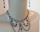 Bella Crystal Necklace and Earring Set In Black