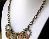 Brass Gear Statement Necklace, Steampunk Jewelry - Antique brass necklace with assorted Steampunk gears