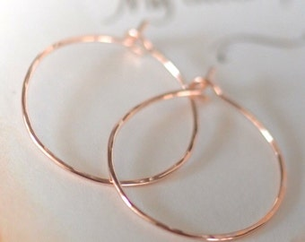 rose gold earrings. rose gold hammered hoop earrings. earrings. gold earrings. petite. modern simple earring. hammered arch earrings.