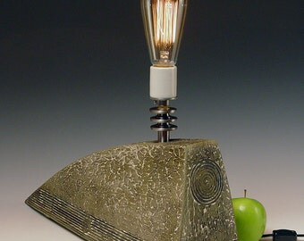 Sculptural lamp. 206.. Monolithic. Flintstone Deco. Dramatic faux finish. Sublimely unique.